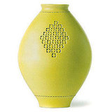 Similarly, the Line Vase ($392), with its pretty cut-out designs, reflects the shape and pattern of the dress.