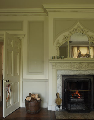 This gorgeous, ornate fireplace is the focal point of the living room.