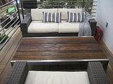 Patio furniture featured weather-resistant materials and reclaimed wood tables.