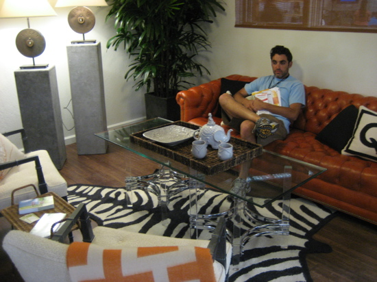 A vintage chesterfield sofa in Hermès orange anchors the living room. A Jonathan Adler zebra rug is a playful addition to the room.