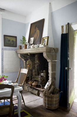 Antique family portraits make the ultimate mantel décor.