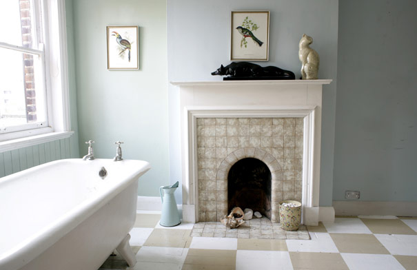 Beige and white painted checkered floors and a soft blue are the perfect palette for a relaxing bath.