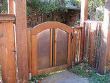The copper and redwood gate's design inspired Lou to create a similar gate at this home.