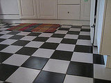 The black and white floors in the kitchen are gorgeous, but Laurel says that they're incredibly difficult to keep looking this spotless. Still, it's a great effect, don't you think?