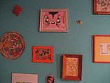 Here's a close-up of the art wall in her bedroom.