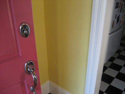 I love the pink and yellow paint colors that meet your eye as you walk into Laurel's house. You know this isn't an ordinary house tour from the door alone.