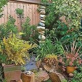 A pebble fountain adds visual interest to low-maintenance plantings.