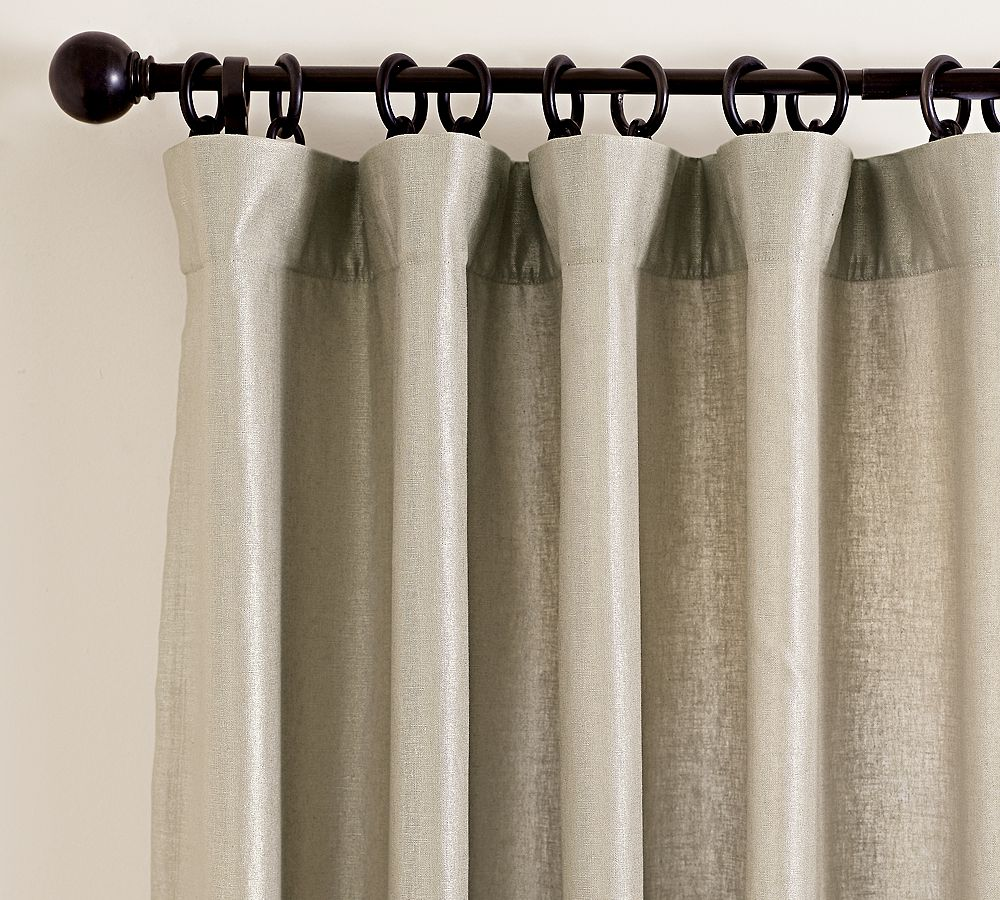 The Pottery Barn Metallic Linen Drape ($99-129) will dress your windows in the same fashion, but you're on your own when it comes to the view.