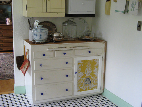 "Andy says, ""When I moved into this house, the kitchen had home depo style cabinets in awful condition. I ripped them out and replaced them with found pieces. ""The drawer unit here was salvaged from my childhood home."""
