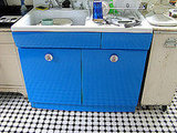 """I took this vintage sink and had the base powder coated bright blue and replaced the knobs with vintage tin ones made to go in a child's room,"" explains Andy."
