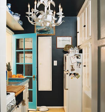 No one ever said kitchens had to be bright. Consider a deep midnight blue in your kitchen. As you can see here, it makes that teal pop! Source