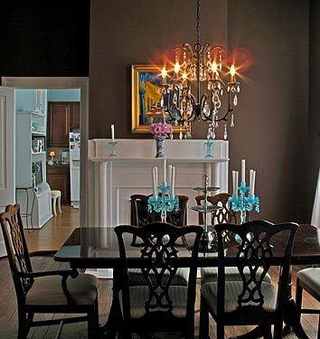 You weren't loving the brown color currently in your kitchen, but had you considered another shade? Here, the chocolate brown walls look seriously glamorous with the teal candelabras. Source