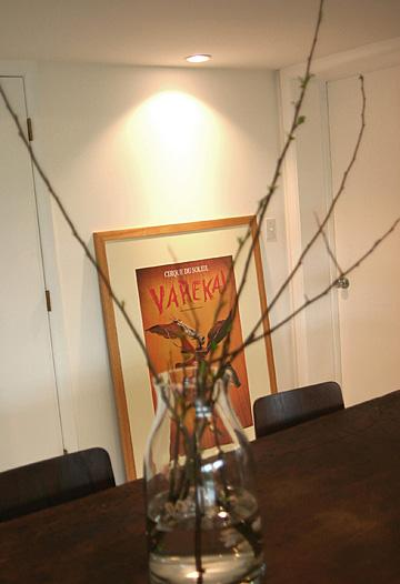 Stark branches create an elongated autumnal centerpiece on the conference table.