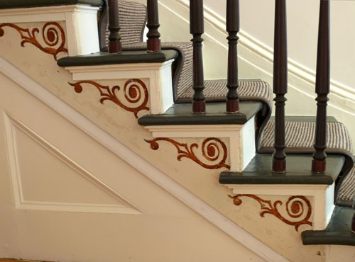 Delicate details like the ornamental painting on this staircase make a stylish surprise.