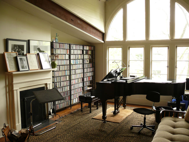 A grand piano and vast album storage are a must for any composer.