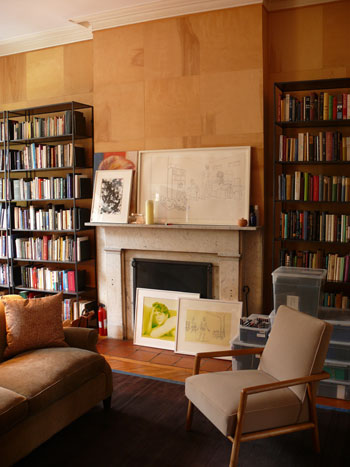 Bookcases flanking a fireplace in the office offer more storage for Sheffer's endless collection of books and media.