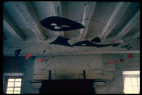 Another of Calder's mobiles adds a modern touch to his traditional home.