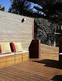 A high wall offers privacy on the back deck.