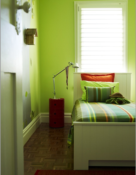 A vintage door knob contrasts with the modern bed frame in this child's room.