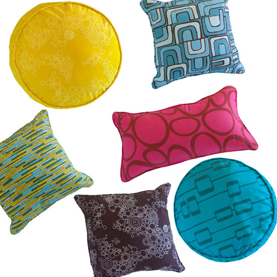 Rug designer Angela Adams branches out into the world of cushions with these brightly patterned pillows. Source