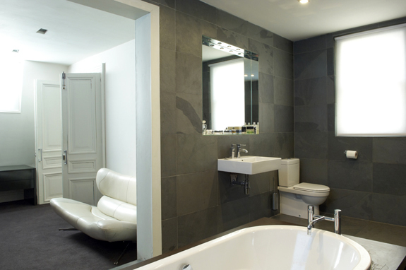An adjacent dressing room adds to this bathroom's luxury factor.
