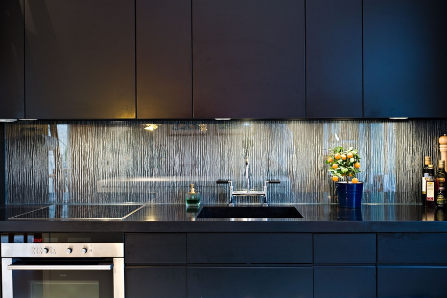 A busy backsplash brings a splash of pattern.