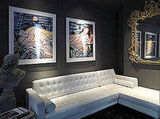 Sleek white seating and oversize art add a glam touch to this seating area.