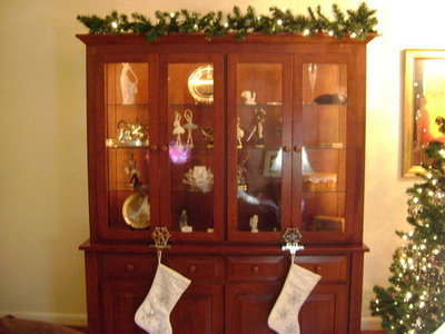 This beautiful china hutch, made by Aimeesbell's husband, displays a set of nutcracker porcelain figurines and is a perfect alternative spot for hanging stockings.