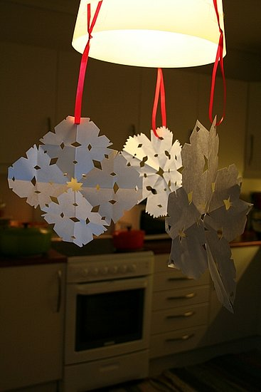 Homemade snowflakes adorn a lamp at Finnlover's home in Norway.