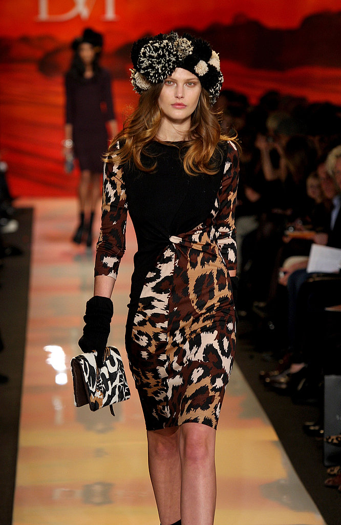 Catherine smokin' in a leopard and black wool drape dress