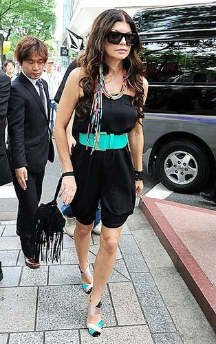 Fergie in Japan Wearing Black Strapless Romper and Turquoise Belt