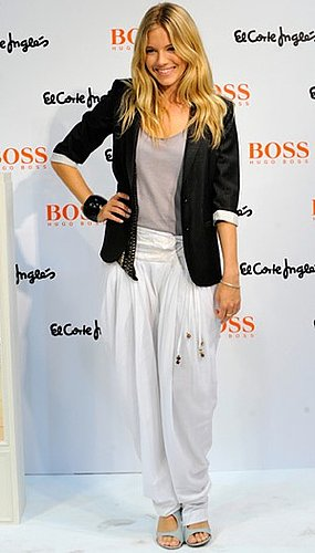 Photo of Sienna Miller Wearing Baggy Genie Pants at Boss Orange Fragrance Appearance in Spain
