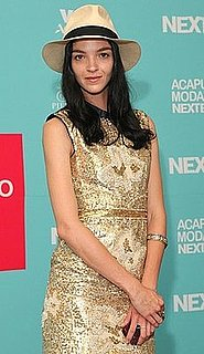 Model Mariacarla Boscono Attends Acapulco Moda Nextel 2009 in Fedora and Gold Dress