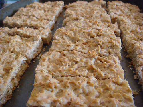 Cutting the baked cookies into bars. 
