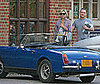 Photo of Kate Moss and Her Blue Convertible in the Cotswolds