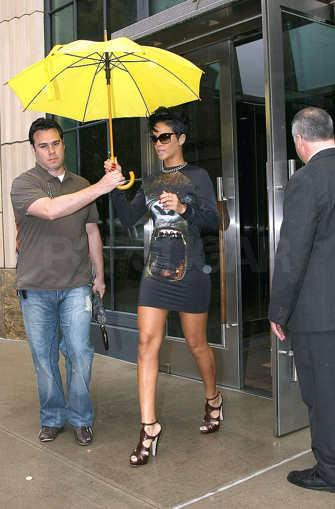Rihanna Has Two Umbrellas