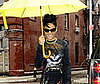 Slide Photo of Rihanna in NYC with a Yellow Umbrella