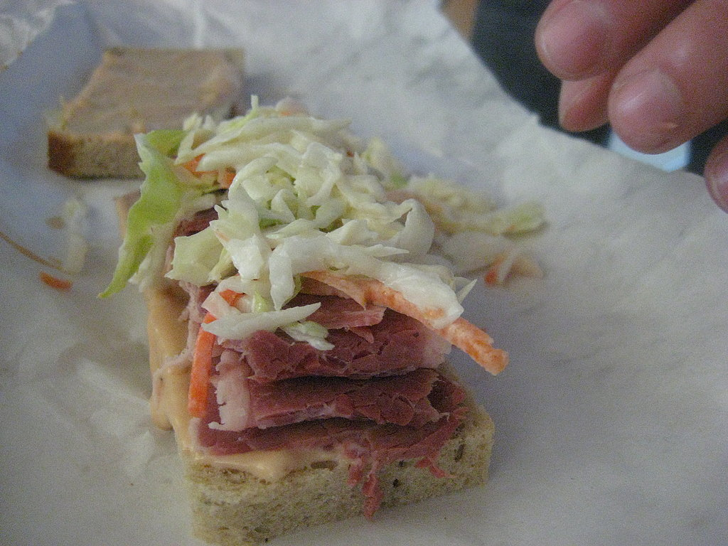Cover with several heaping tablespoons of coleslaw.