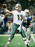 Despite his skill, quarterback Dan Marino (No. 13) never won a Super Bowl.