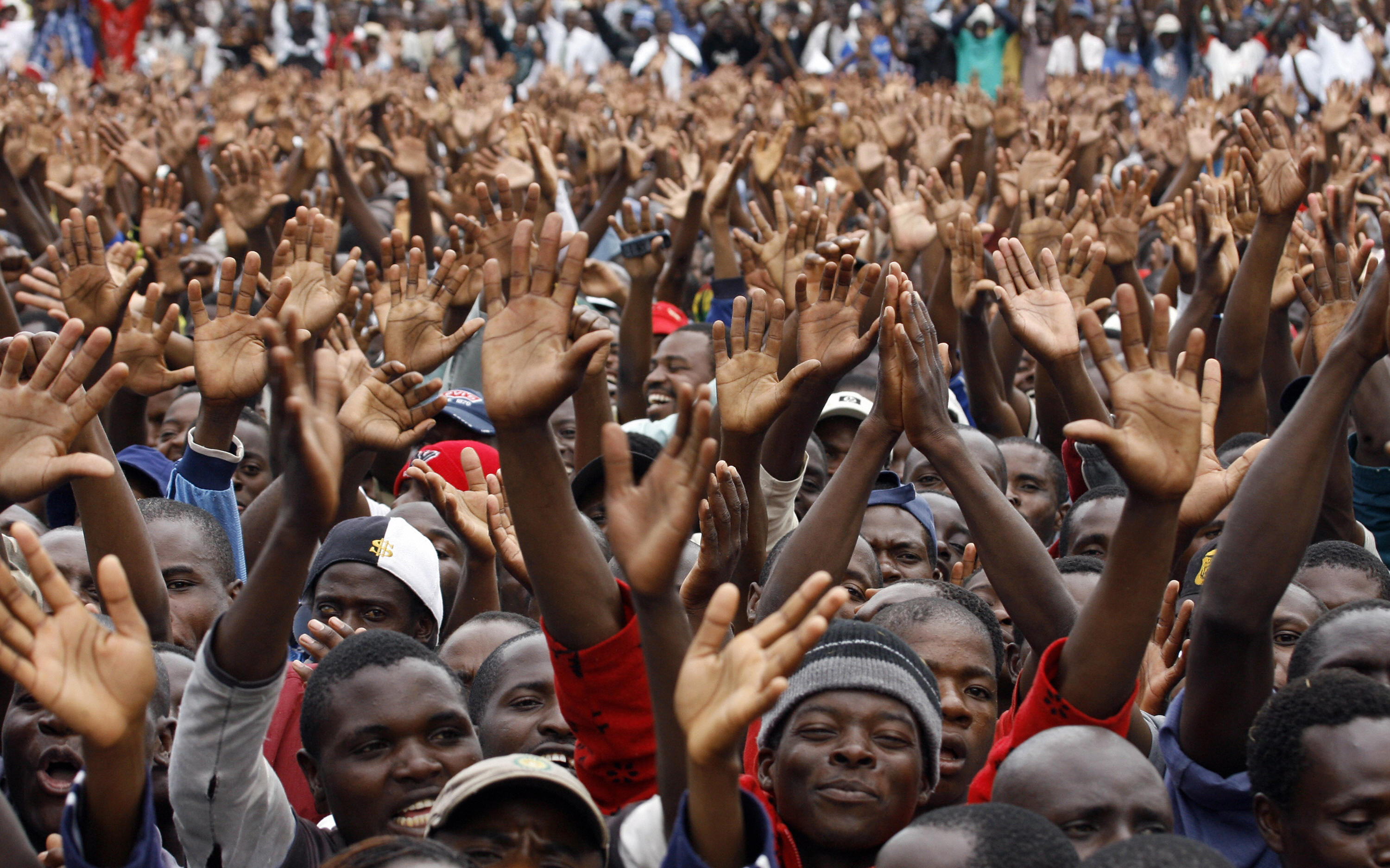 Zimbabaweans greet their new Prime Minister.