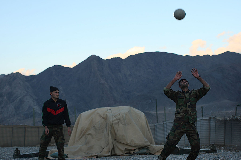 Members of the Afghan National Army play a game of volleyball on US Army Forward Operating Base.