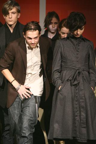 in front - fashion designer Rolands Peterkops. behind the model - fashion designer Marite Mastina.