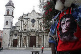 A Cuban wears a shirt bearing the likeness of Marxist revolutionary Che Guevara