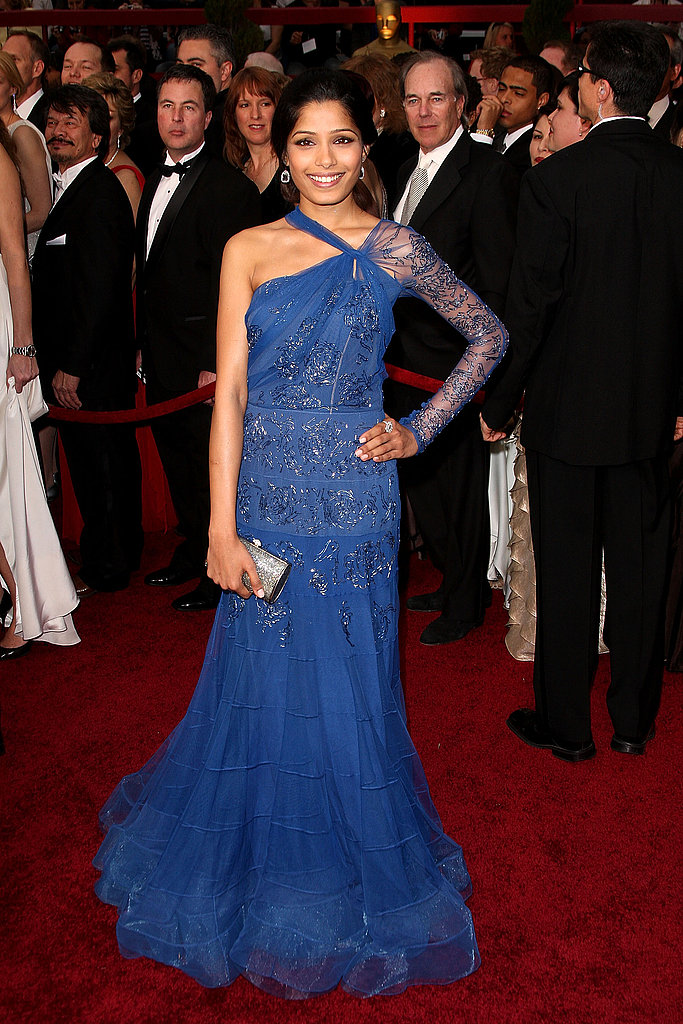 Freida Pinto made her red carpet debut in a beaded sapphire John Galliano gown.