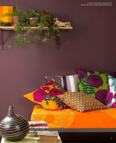 A subdued, calm wall color, like this meditative purple, works beautifully with brighter textiles.