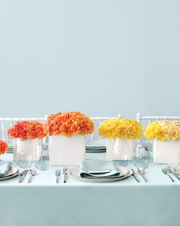 Martha Stewart Weddings recommends using minimalist, modern containers to really help carnation arrangements pop.
