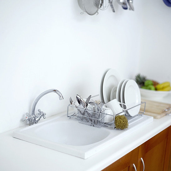 If you wash your dishes by hand, learn the most water-efficient way to wash them.