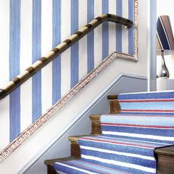 Vertically striped walls, a diagonally striped banister and lampshade, and a horizontally striped stair runner play off of each other on this stairwell. It's busy, but somehow the cohesive palette keeps it sane. Source