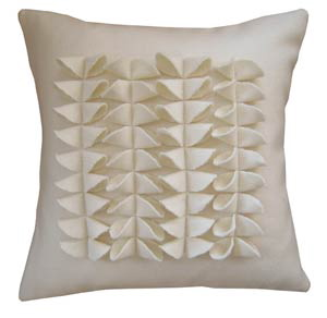 Go white and sculptural with the LoooLo La Rue Pillow ($190-230). It's an eco product handmade with certified organic materials. The pillows are filled with Kapok from rainforests in Malaysia, and are also available in a range of colors.