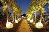 Line a walkway for a party or a wedding with illuminated parasols. Source